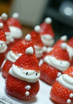 """Strawberry Santas!  1 lb large strawberries  1 (8 ounce) package cream cheese, softened  3-4 Tablespoons powdered sugar   1 teaspoon vanilla extract    1. Cut and remove the top. Clean out the whole strawberry.    2. Beat cream cheese, powdered sugar, and vanilla until creamy. Add cream cheese mix to a piping bag or Ziploc with the corner snipped off. Fill the strawberries with cheesecake mixture.    3. Top with """"hat""""!"""