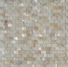 this mother-of-pearl backsplash tile with gold undertones