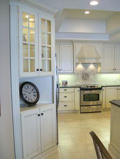 Antique White Lacquer Cabinets, Uba Tuba Granite Tops.