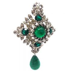 1960 Christian Dior Vintage Jewellery - SOLD OUT - Faux Emerald and Crystal Rhinestone Brooch Gigantic ! A spectacularly large, rare and magnificent DIOR piece. This very substantial brooch is exquisitely set with rhinestones and an art glass centerpiece and dropper and is literally wall to wall exquisite fancy rhinestones, cut in either elaborate marquise or pear shape. These stones have an incredible brilliance due to the extensive stone cutting methods used couture houses such as DIOR.