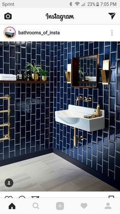 like an accent wall of tile and the suspending sink for small space