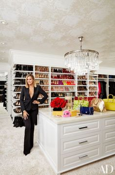 Khloé Kardashian stands in her California closet, which is lined with shoes. | archdigest.com