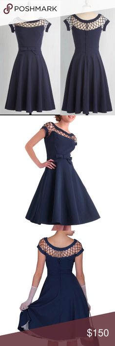 Alika Navy Vintage Dress Bettie Paige XL NWT Short sleeve circle dress with a circle skirt. Lattice style around neckline and sleeves. The waist features a bow at the center that leads to its full circle skirt. Three eye hook closures are above the back zipper. Crinoline sold separately.  80% polyester 15% viscose 5% spandex  Hand wash with cold water - Flat dry - Dry cleanable Vintage Dresses Midi