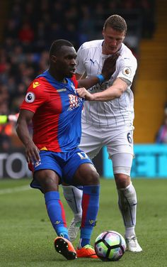 Christian Benteke of Crystal Palace and Robert Huth of Leicester City battle for possession during the Premier League match between Crystal Palace and Leicester City at Selhurst Park on April 15, 2017 in London, England.