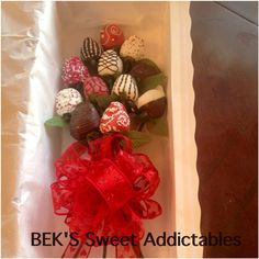 Long Stem Chocolate Covered Strawberries by BEK's Sweet Addictables in BRP Box Shop's long window box.