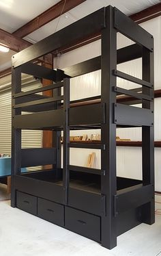 "Custom Twin over Twin Bunk Bed with optional headboards, reading lights and drawer storage. This bunk bed is 107"" tall and is customized with a custom top valence at the ceiling line. Shown in a custom black lacquer finish."