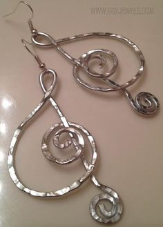 """G-CLEF style sample (shown in Silver). $16    ---------------------------------    GGX Best Seller: BANGIN' BEAUTIES hand-hammered aluminum wire earrings.    Please note, due to the fact that every pair is hand-crafted, items ordered will not be identical - but, you can request a custom """"style"""".    Colors currently available: silver, bright gold, old gold, copper, light purple, baby pink, peridot green, blu-rple, red, turquoise"""