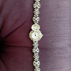 "Marcasite Bracelet Watch This beautiful marcasite watch looks like a bracelet until you lift the cover and reveal the working watch.  The bracelet has a clasp closure and the bracelet measures approximately 7"" end-to-end. Jewelry Bracelets"