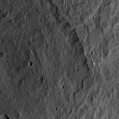 Dawn HAMO Image 68 -  This view from NASA's Dawn spacecraft shows the rim of the large impact feature named Yalode in the southern mid-latitudes on dwarf planet Ceres. Linear, roughly parallel features are visible in the crater wall.