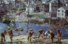 American troops clear wreckage in Saint-Lô, Normandy, 1944. | The Ruins of Normandy: Unpublished Color Photos From France, 1944    Read more: http://life.time.com/history/after-d-day-unpublished-color-photos-from-normandy-summer-1944/#ixzz2WnWYQpXv