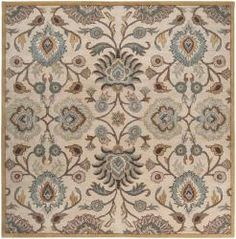 Hand-tufted of wool, this rug features a floral design with a plush pile. Shades of beige, gold, blue, brown, ivory and gray accent this area rug. Primary materials: Wool Pile height: 0.625 inches Sty
