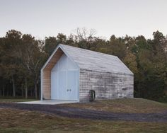 The Shed / Hufft Projects. Conceived as a kit of parts, the elegant building's steel frame combines modular wall components, roof trusses, and battens, all of which were assembled on site and clad with a rain-screen of White Oak taken from the property.