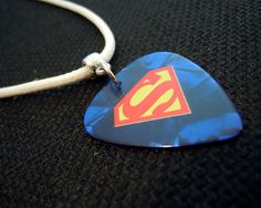 Superman Guitar Pick on White Leather Cord Necklace by ItsYourPick on Etsy