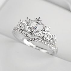 DESCRIPTION DETAILS Unique and beautiful this ring features ultra shine cubic zirconia crystals arranged in a princess crown design Ring Silver Alloy Ul. Engagement Rings Princess, Floral Engagement Ring, Shop Engagement Rings, Vintage Engagement Rings, Crown Engagement Ring, Princess Promise Rings, Unique Silver Rings, White Gold Rings, White Gold Diamonds