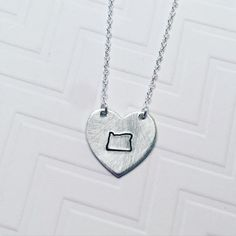 A personal favorite from my Etsy shop https://www.etsy.com/listing/258196970/hand-stamped-oregon-personalized-silver