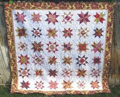 Bring a sky full of colors to your bedroom quilt with this Custom Starry Bed Quilt. This queen size bed quilt uses star quilt blocks that you can customize with your own color scheme in order to create a one-of-a-kind quilt for your comfort. The easy