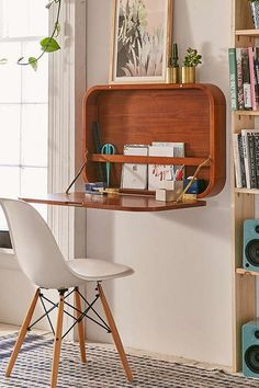 Mount a fold-down desk to the wall and use it whenever you need.