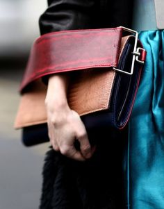 Behold, the Best Accessories From the Paris Fashion Week Style Set: We can't get enough of the bold arm strap on this colorblocked clutch.