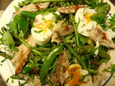 Salad with poached eggs and mackerel