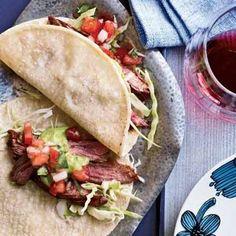 Fresh pico de gallo dresses up carne asada tacos.