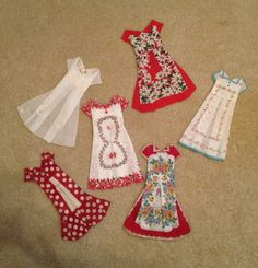 Hanky Dresses I made with vintage hankies. Sweetheart gifts. Folded & ironed to perfection then sewn as miniature dresses.