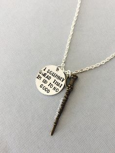 """This handstamped necklace is inspired by Harry Potter. It features the words, I solemnly swear that Im up to no good, accented with a bronze wand charm.  Each necklace is made to order, and each letter is stamped individually by hand, every necklace will be slightly unique. The product you receive may vary from the photo shown. Charms and beads will remain the same.  The hand stamped charm is ¾"""" aluminum. It will have a brushed finish. Chains are nickel and lead free. If you need this item…"""