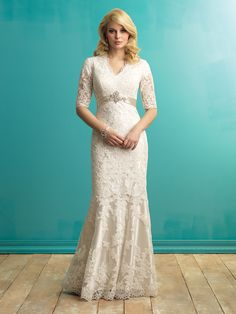 This gorgeous style is created from lace applique, featuring lace sleeves and a satin empire waistline - accented with Swarovski crystal detail. See store for availability and pricing.