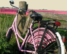 pink bike with knit