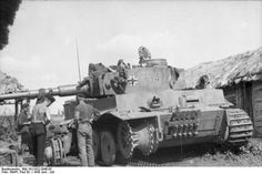 German tankers replacing a damaged track on a Panzer VI Tiger I heavy tank, Kursk, Russia, Jun-Jul 1943 (PhotographerPaul Wolff, German Federal Archives.)