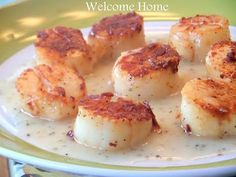 Seared Sea Scallops with Lemon Cream Sauce * drool*... might have to save this until I can get fresh scallops right out of the ocean in Nova Scotia!