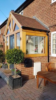 A Glazed Oak Porch used to add character and sat on a brick dwarf wall. Read this and other interesting case studies from Oak By Design Brick Porch, House Front Porch, Front Porch Design, House Entrance, Enclosed Front Porches, Small Porches, Porch Extension, Front Porch Addition, Cottage Porch