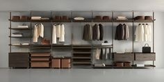 """""""Zenit"""" Wardrobe with brown aluminum structure, shelves and drawer units in coal larch melamine. (by Rimadesio)"""