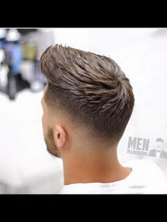 Graduated Crop With a Fade. Aveda Mens Styling pomade was used to get this look