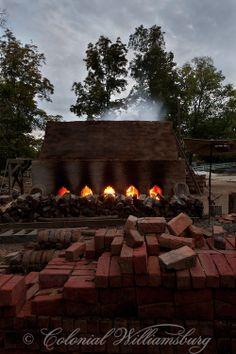 Firing the brick kiln at dusk.
