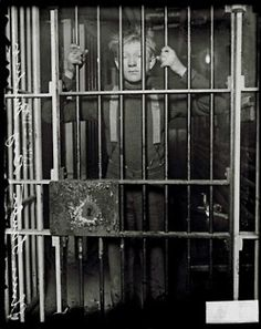 "Elmer Fanter, the ""Boy Murderer,"" standing behind jail cell bars, March 2, 1915. DN-0064142. #chicago #history #crime"