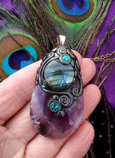 Luna Blue's Silver Frost Amethyst and Sea Green Flash Labradorite Crystal Energy Pendant. $58.00, via Etsy.