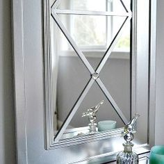 upcycle a cheap door mirror, home decor, It s amazing what a little molding and paint can do to transform something basic or old into custom one of a kind pieces for your home