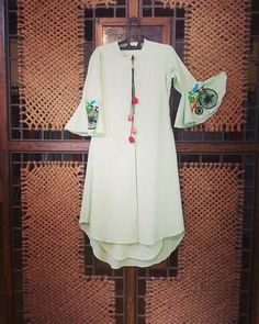 Bright floor length dress in cotton with hand embroidered cycle motif and tassle detailing in front. This breezy outfit is the perfect example of casual chique. Indian Attire, Indian Wear, Kurta Designs, Blouse Designs, Indian Dresses, Indian Outfits, Indian Designer Wear, Dress Patterns, Kurta Patterns