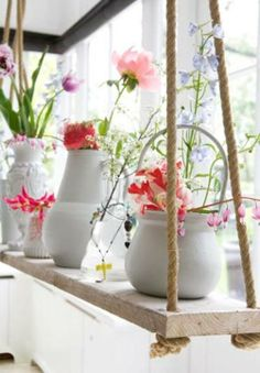 Hanging plants for sunroom - might work well for our bay window, lots of light but no floor space there!
