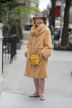 "ADVANCED STYLE: Full of Joy.  ""I often see this woman walking uptown and she always has on the most wonderful coats and hats. When I asked her about her coat she responded, ""It gives me joy to wear things that I love."""