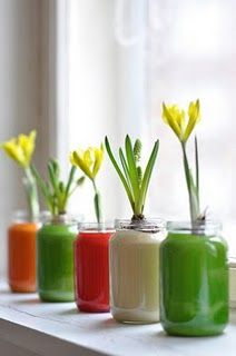 Use baby food jars, pour in paint, roll it around, and voila--colorful vases!