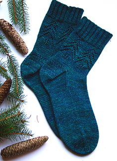 Created from a desire for a quick & easy pine tree sock pattern, Evergreen Socks are a perfect project to curl up with during the chilly winter season. This pattern is great for beginning lace knitters and/or beginning sock knitters as the lace pattern is very intuitive and knits up quickly.