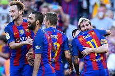 Lionel Messi of FC Barcelona celebrates with his team mates after scoring his team's fourth goal during the La Liga match between FC Barcelona and RC...
