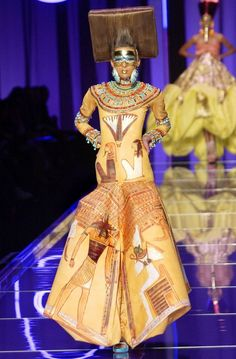 This post, with the ancient Egypt theme, segues nicely from my previous one. Apparently John Galliano took a hot air balloon tour of Egypt when was researching his Spring 2004 haute couture collection for Christian Dior. John Galliano, Galliano Dior, Christian Dior Couture, Haute Couture Fashion, Christian Lacroix, Issey Miyake, Egyptian Fashion, Conceptual Fashion, Couture Collection