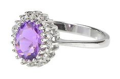 $60 Delivered!! Special Promotion this week only!! Genuine Diamond and Amethyst ring set in .925 Sterling Silver. Like us on Facebook for an additional coupon. We have a great selection of diamond jewelry - most under $99 delivered!! Check out www.Jewelryland.com for a great selection of high quality jewelry at extremely reasonable prices. Please feel free to re-pin, comment or like any of our jewelry.