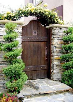 Rustic Landscape/Yard with Garden Passages Designer Wood Gates, Barn door, Stacked stone wall, Exterior stucco walls, Arbor
