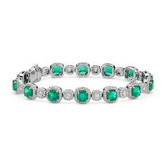 An exquisite complement to any style, this dramatic gemstone bracelet showcases vibrant emeralds highlighted by a dazzling halo of pavé-set diamonds framed in 18k white gold. Cushion-Cut Emerald and Pavé Diamond Halo Bracelet in 18k White and Yellow Gold