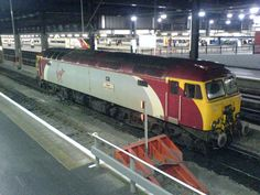 """Virgin Trains locomotive 57307, """"Lady Penelope,"""" parked at Euston Station, London. A group of diesel-electric locomotives designated as """"rescue"""" haulers are all nicknamed for """"Thunderbirds"""" characters. These units move in to pull passenger trains  and keep to schedule when problems develop on the predominately electrified railroad."""