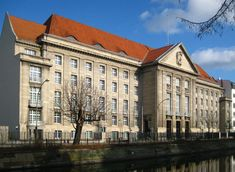 """Berlin: the building that housed the High Command of the German Armed Forces in WW2. Abwehr headquarters were on the third floor. The water in front is the Landwehr Canal.----""""Just after 8.45am, the car turned into Tirpitzufer, a wide, straight street with buildings on one side and a row of chestnut trees and the Landwehr canal on the other. The driver began to slow as they approached a long, five-storey, grey granite building that was situated a few hundred metres away ...""""…"""