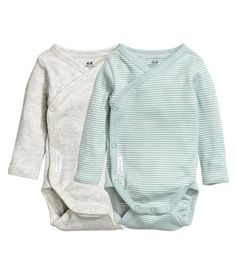 Mint green/striped. CONSCIOUS. Wrap-front bodysuits in soft, organic cotton jersey with long sleeves. Snap fasteners at side and gusset.